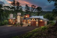 This organic modern mountain home designed by Living Stone Design + Build and ID.ology Interiors is located in Asheville, North Carolina.