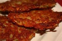 ~~~~ POTATO PANCAKES ~~~~ -   *  4 or 5 pototoes peeled  -   * 1 egg  -  *salt and pepper  -  *  flour to thicken  >>>>    Peel potatoes then grate them. Add egg, salt and pepper to taste. Add enough flour to thicken to a good batter consistency. Cook in a well buttered heavy skillet. Turning over once. Remove to paper towel to drain.    Good  for breakfast or a side dish with supper. Enjoy !!