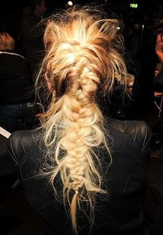 We love a good messy fishtail braid, but this runway-ready style takes it to a whole new level.