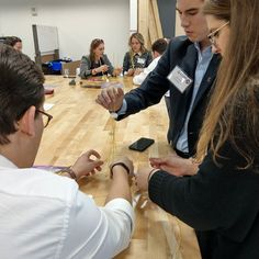 Young Alumni doing the Marshmallow Challenge in the Maker Hub...and breaking the rules. Marshmallow goes on top. #elonhome
