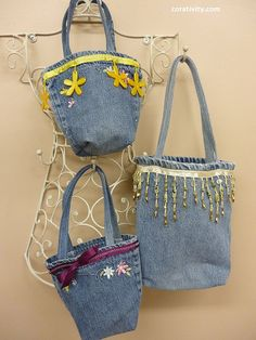 Love the idea of using the legs of jeans to create cute little tote bags to embellish! [great way to use all that scrap material left over from making jean skirts!] : ) ...could put pockets on front or inside to hold your cell phone!