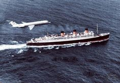 Queen Mary and a plane