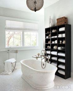 Black shelves, white bathroom