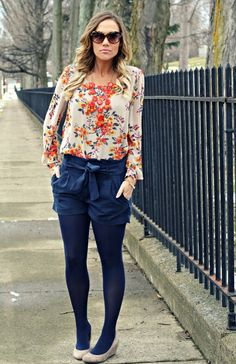orange bubble necklace with floral top and navy shorts, tights and heels