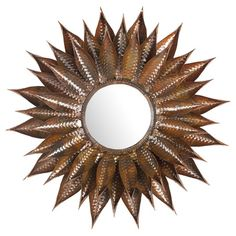Circular wall mirror with a wrought iron floral frame.      Product: Wall mirror  Construction Material: Wrought iron...