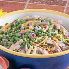 "Ham and Pea Salad Recipe -In Ephrata, Washington, Laura Whitney needs just five ingredients to create this quick colorful salad. ""I work days and have little time to spend in the kitchen, so I look for all the shortcuts I can find,"" she explains. Pea Salad Recipes, Pea Recipes, Amish Recipes, Summer Recipes, Healthy Dinner Recipes, Cooking Recipes, Dutch Recipes, Cooking Tips, Healthy Food"