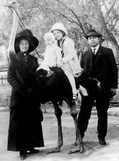 Myrna Loy, riding an ostrich with her younger brother David, surrounded by her parents Adelle and David Sr (1912)