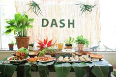 Dash, Three Years: A Dinosaur Party - love the giant leaves for a table cloth!