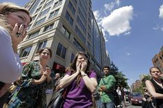 Office workers gather on the sidewalk in downtown Washington, D.C., moments after a 5.9-magnitude earthquake shook the nation's capital. The earthquake was centered northwest of Richmond, Va., but could be felt from North Carolina to Massachusetts.