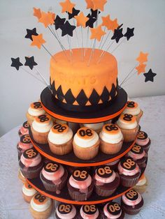 Graduation Cake (I could put the number on cupcakes and they sell pretties to put in the cake like they did the stars in this pic)
