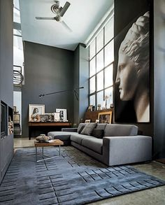modern home interior gray living room gray sofa area rug wall art ceiling fan