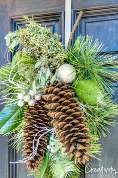 Christmas pine wreath swag with large sugar pine cones and fresh juniper berries.