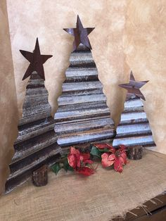 Rustic corrugated tin Christmas trees by RustinRose on Etsy https://www.etsy.com/listing/256458049/rustic-corrugated-tin-christmas-trees