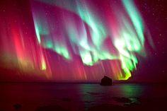 Nighttime aurora over the sea. moonlightcity:    (by HerraM)