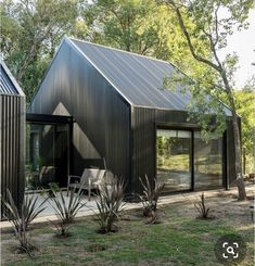 morini black house, 'la negrita,' is nestled among a forest in argentina Shed Homes, Prefab Homes, Cabin Homes, Sustainable Building Design, Modern Barn House, Modern Houses, Shed House Plans, Parametric Architecture, House Architecture