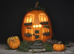 "This pumpkin carving project only takes up about 30 minutes.  To begin, carve the pumpkin from the bottom. Then with a chalk pen, draw an outline of your home and carve it with a Dremel tool. For the final step, decorate the house with acorns and moss and of course place a candle inside and let your ""home"" illuminate."
