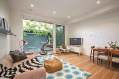 Living Room Ideas | Stalking South Yarra  Note: sofa, rug and beanbag
