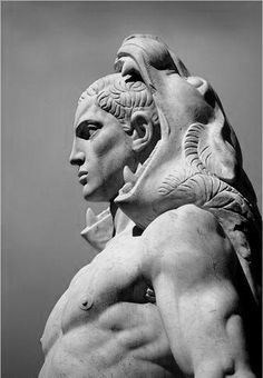 Hercules by Silvio Canevari (1931), Stadio dei Marmi, Rome. You can see Art Deco influences in the stylization of the hair and fur.