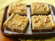Eggnog Cheesecake Bars  Cheesy baked bars topped with almonds - perfect dessert to impress your guests.
