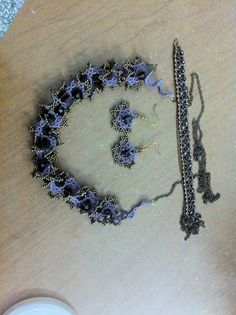 My purple Oglala necklace with earring. With matching embellished netted bracelet.