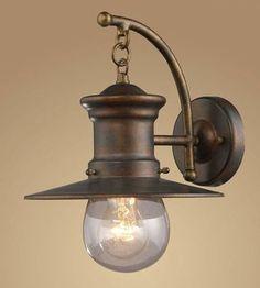 Features:  -One light outdoor wall lantern.  -Clear seeded glass.  -Hazelnut bronze finish.  Lighting Type: -Barn Light.  Finish: -Hazelnut bronze.  Hardware Finish: -Hazelnut bronze.  Fixture Materia