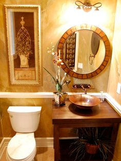 One great aspect of small bathrooms is the fact that a smaller room requires fewer furnishings. For this reason, half baths and powder rooms are the perfect places to splurge on high-end pieces, like the copper vessel sink featured here.