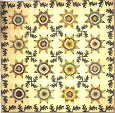 The E. A. Scofield quilt, 1850, by Esther Scofield.  Collection of the Darien (Connecticut) Historical Society. This cotton quilt has a pattern of eight-point stars and appliquéd oak leaves.