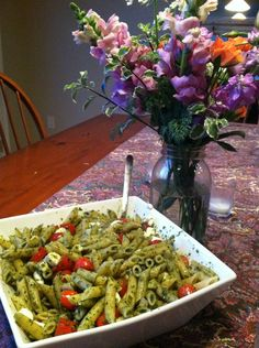 Pesto Pasta! Made into a dish with fresh cherry tomatoes and sliced mozzarella cheese.  | Healthy Recipes