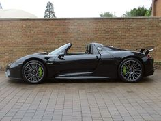 Romans are pleased to offer this Porsche 918 Spyder for sale presented in Basalt Black with Onyx Black Leather & Acid Green Piping. Used Porsche, Porsche Boxster, Porsche Cars, Unique Cars, Modified Cars, Car Photos, Amazing Cars, Hot Cars, Exotic Cars