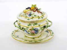 "Le Chateau Soup Tureen - 	Exquisite porcelain soup tureen with wonderfully detailed cover and pretty under plate 1.25"" L."