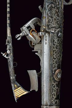 A silver-mounted flintlock gun,    Morocco,  mid-19th Century.