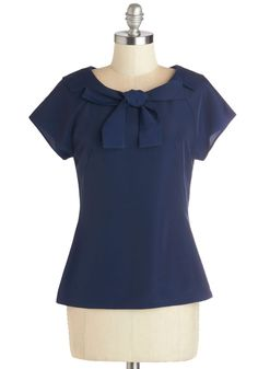It's Bow or Never Blouse, #ModCloth-- For someone as clever and organized as you, this smart, navy-blue blouse by Myrtlewood makes the grade. The statement bow collar of this short-sleeved, ModCloth-exclusive top gives way to your fun-loving professional side. Darting along the chest and a back zipper closure pulls together your look and inspires confidence for your Monday morning meeting.