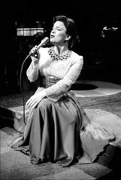 """Patsy Cline...""""We'll sip a little glass of wine, I'll gaze into your eyes divine, I'll feel the touch of your lips Pressing on mine.  To hear you whisper low, Just when it's time to go, """"Oh, darling, I love you so!"""" That's my desire!"""""""