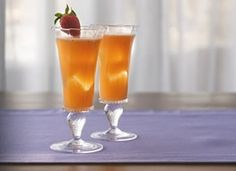 Sunrise Mimosas! * 1  package (10 oz) frozen strawberries in syrup, thawed, undrained * 3  cups 100% tangerine juice (made from frozen concentrate) * 2  bottles (750 ml each) champagne, chilled
