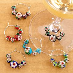 These were my very first wine glass markers - and still my favorites!!  Cloisonne Wine Charms, Set of 6 | World Market