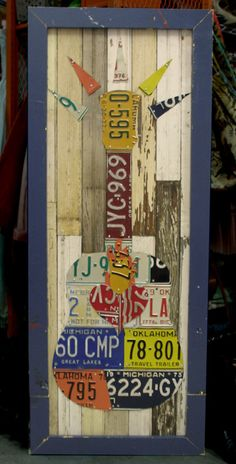 Junk Gypsy license plate guitar /// diy wall art