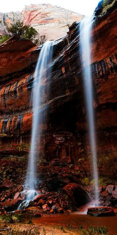 Look at this waterfall falling over this rock!