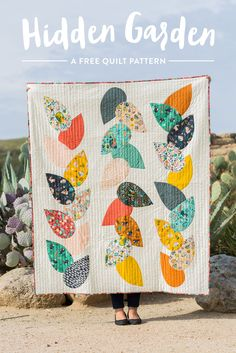 This free quilt pattern is a great design to show off those big beautiful prints you've been hoarding. It uses raw edge appliqué​, so in addition to being fairly simple to sew, it's super quick too!