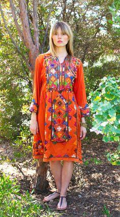 Love this orange afghani dress