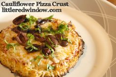 Cauliflower Pizza Crust Recipe, sooooo delicious, and it's even low carb! via littleredwindow.com