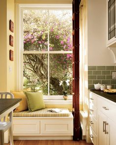 love this reading spot in a kitchen- might be perfect for a sunny corner in our kitchen.