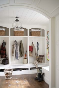 cute mudroom (especially like the arched hall ceiling with moulding and the planked mudroom ceiling; the compass detail on the floor is charming) (contemporary entry by MuseInteriors) (Houzz.com)