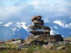 "You know those piles of rocks on trails? If you see one, it's called a ""cairn"" and it's put there (by rangers or other hikers) to mark the way in terrain where the trail isn't obvious, like above timberline in rocky areas. This cairn is in Grand Valley in the Olympics. Photo by Hikingqueen."