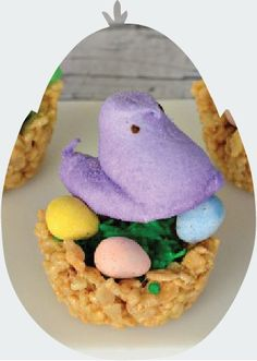 Rice Krispies Treats nests, filled with speckled chocolate eggs and Peeps, are super-adorable Easter desserts you can make with your kids in less than 15 minutes!