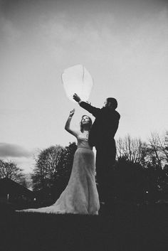 Bride and Groom setting off a sky lantern in black and white Alex & Julia // WEDDING · Jessi Livak Photography www.jessilivak.com