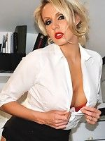 Once Dannii Harwood gets home from a long hard day at the office, she immediately likes to get out her tight skirt and blouse. She then likes to parad