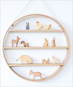 15 Decor Ideas For Creating A Woodland Nursery Design // Wooden woodland creatures are likely going to be included in your nursery so make sure you've got the perfect shelf to display them on.