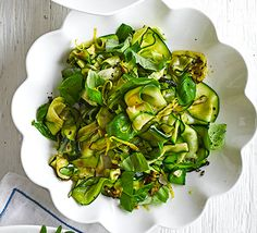 Warm lemony courgette salad. A healthy, vibrant salad of shaved courgette, citrus and basil. Serve as a gluten-free starter or side dish