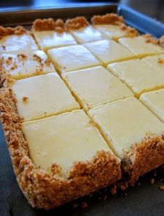 CREAMY LEMON SQUARES: FOR THE CRUST 4 tablespoons butter, melted and cooled, plus more for pan cup graham cracker crumbs ¼ cup sugar FOR THE FILLING 2 large egg yolks 1 can ounces) sweetened condensed milk ½ cup fresh lemon juice lemons) How Low Carb Dessert, Dessert Bars, Paleo Dessert, Dinner Dessert, Dessert Food, Biscuits Graham, 13 Desserts, Easy Lemon Desserts, Key Lime Desserts