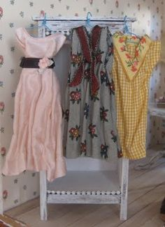 miniature vintage dresses.   Fabric is so hard to do right on miniatures: very impressed by these.